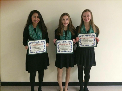 Three Lewiston-Porter students were honored at the Dec. 22 school board meeting for their research presented at the International Students Science Fair in Melbourne. From left, they are: Amrita Singh, Natalie Smith and Emma Waechter. The Lew-Port team placed second out of the 28 participating schools.