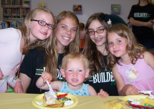 Members Olivia Shackelford, Nicolette Radomski and Courtney Gunderson are shown with Emily and Natalie Shackelford at the Youngstown Monthly Story Hour.