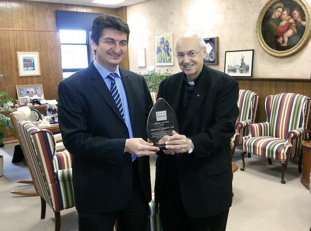 The Rev. Joseph L. Levesque, Niagara University president, receives the 2012 Service Award from Tevfik Kosar, Ph.D., a member of the Turkish Cultural Center at Buffalo's board of advisers.