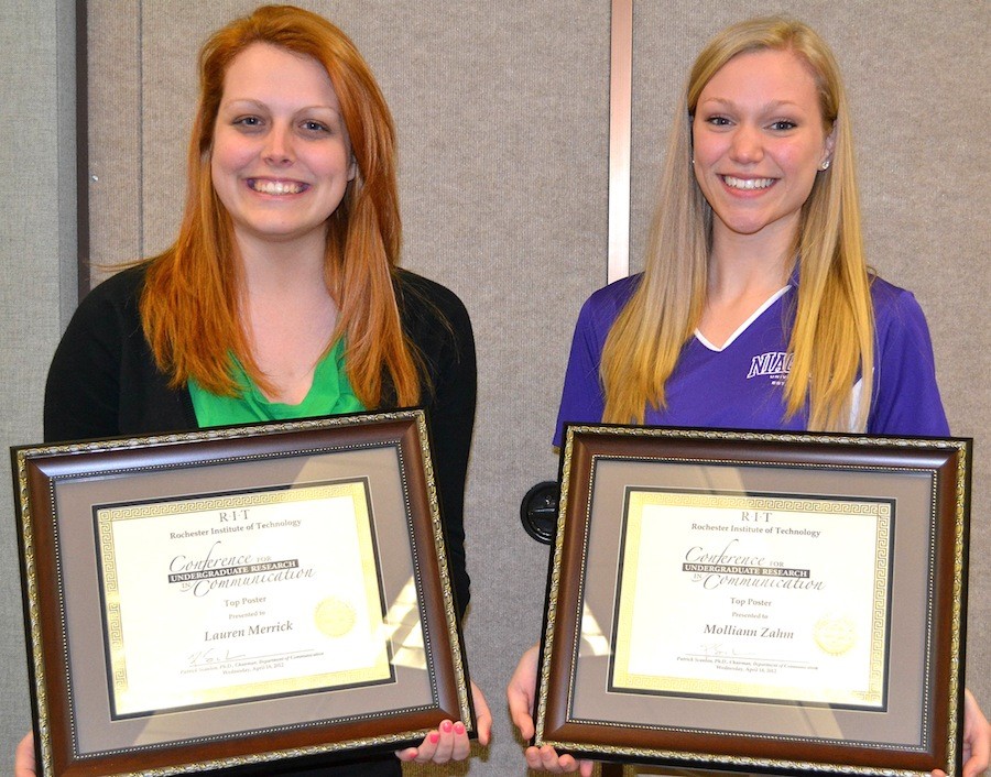 Niagara University seniors Lauren Merrick (left) and Molliann Zahm were presented with awards for presentations they made at the Conference for Undergraduate Research in Communication, held April 18 at the Rochester Institute of Technology.