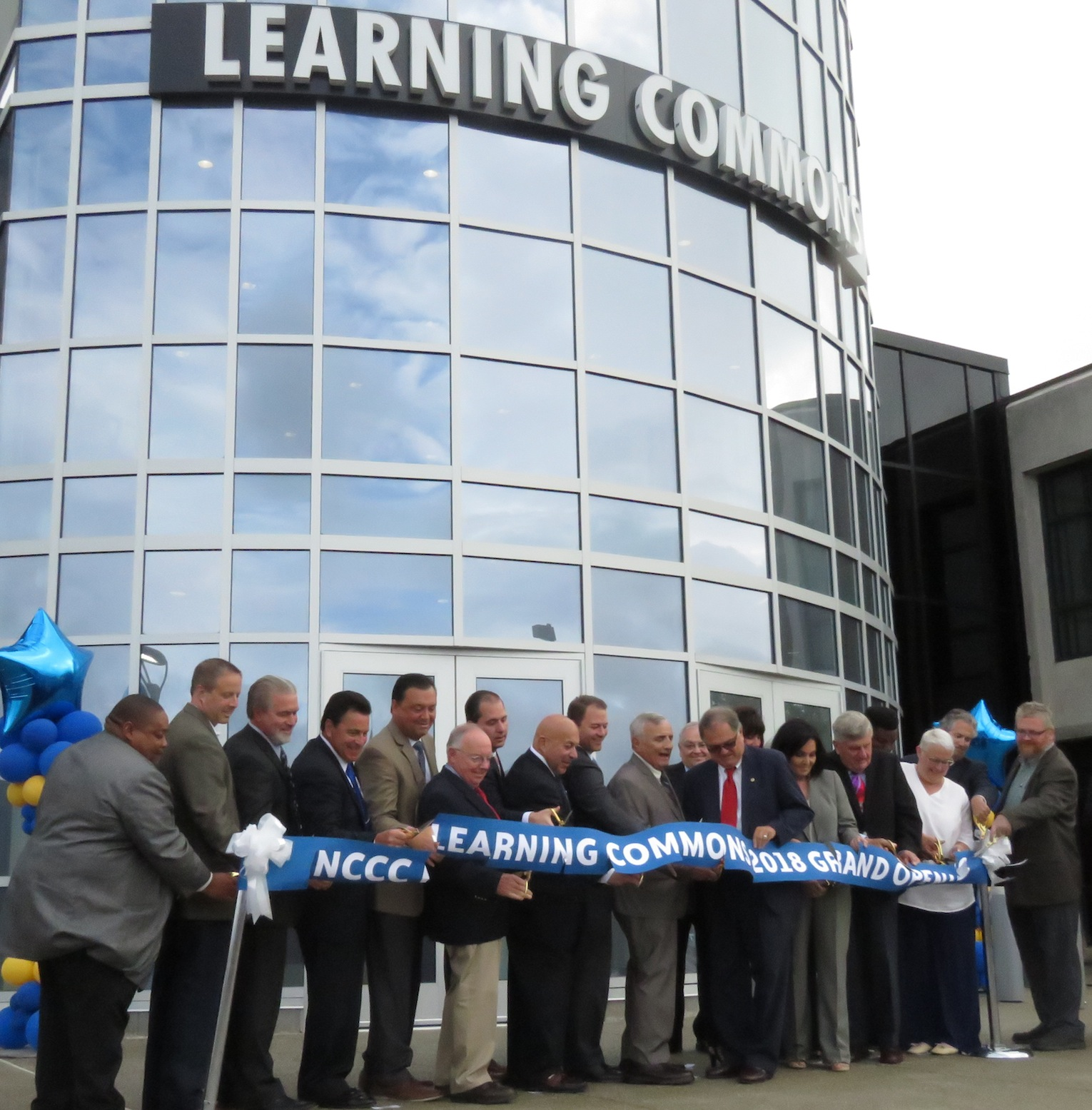 Niagara County Community College trustees, elected officials and more cut the ribbon to the new Learning Commons facility at the Sanborn campus. (Photos by David Yarger)