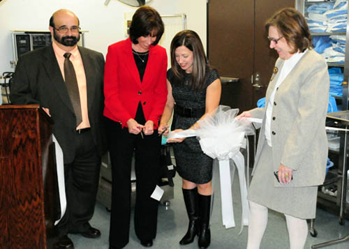 Shown from left are Dr. Sal Passanese, chair of Niagara County Community College's Life Sciences Division, Bonnie Gifford, chairwoman of the board of trustees, Gemma Fournier, Surgical Lab Program coordinator, and Luba Chliwniak, vice president for academic affairs at a ribbon-cutting for the new lab.
