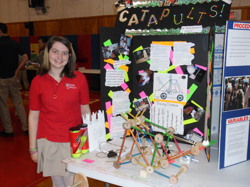 Niagara Catholic High School student Allyssa Wadsworth proudly displays her `Showcase of Talent` project `Catapults & Their Usefulness Throughout History.` The sophomore student hypothesized that any high school student could design and build a working catapult. Wadsworth's  catapult propelled a tennis ball 30 feet.