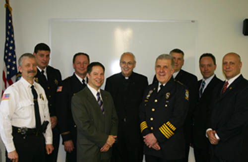 Pictured from left: Lockport Police Chief Larry Eggert; Niagara County Sheriff James R. Voutour; North Tonawanda Police Chief Randy Szukala; Jay Stockslader, director of NU Continuing Education; the Rev. Joseph L. Levesque, C.M., president of Niagara University; Niagara Falls Police Superintendent John R. Chella; Ron Winkley, a criminal justice professor at NU; Niagara Falls Police Officer Nicholas Ligammari; and Niagara County Sheriff's Sgt. Kevin Smith.