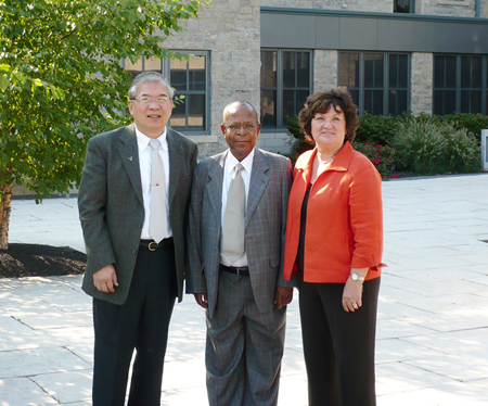 Pictured from left: Dr. Charles Chanthunya, founder and chancellor of Blantyre International University, is flanked by Dr. Tenpao Lee, interim dean of NU's College of Business Administration, and Myriam Witkowski, the college's assistant dean.