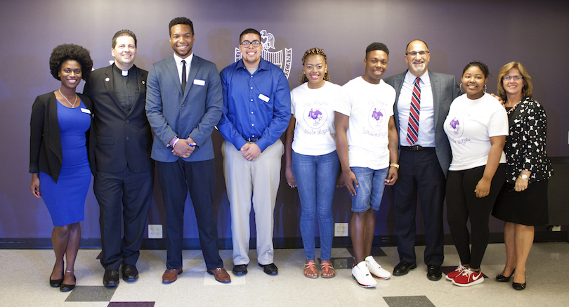 Pictured at Tuesdays' announcement of the Big Eagle Little Eagle program are, from left, Niagara University student Simone Beckford; the Rev. James J. Maher, C.M., NU president; NU students Eric Rigg, Caton Charleston, Latricia Agee and Taundrea Ross; Mark R. Laurrie, superintendent of Niagara Falls City Schools; student Ferrah Staley; and Dr. Debra Colley, Niagara University's executive vice president.