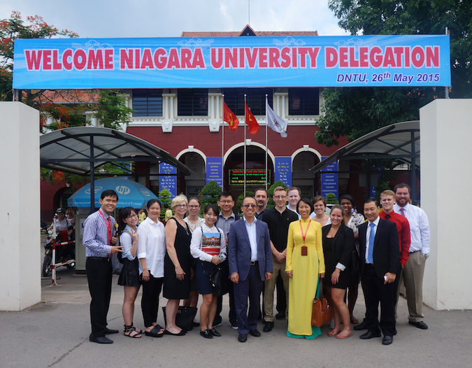 Participants of Niagara University's Global Trade Mission are welcomed to Vietnam by representatives from Dong Nai Technology University.