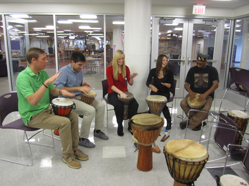 Niagara University students participate in an African Drum Circle as part of a remembrance ceremony for the late Dr. Brian Martin Murphy. He was instrumental in organizing NU's upcoming `Niagara Reaches Out to the World` event. (photo by Chelsea Pelsone)