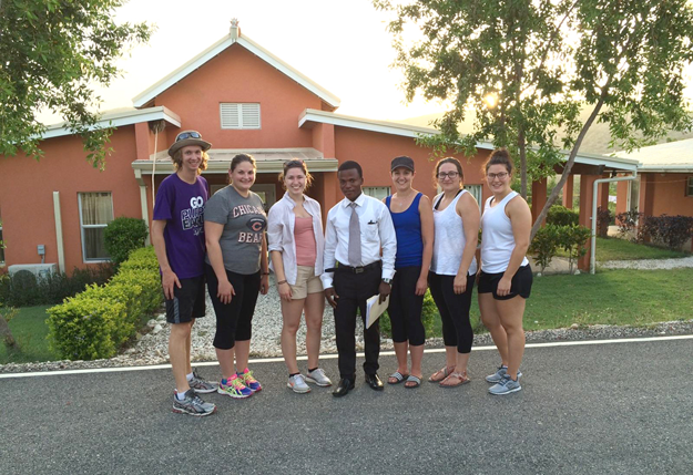 NU students Tyler Van Leeuwen, Tara Topolski, Amber Mis, Bailey Rudow, Bethany Bouthillier and Erin Burns are pictured with Josue, the volunteer program coordinator at Lycée Jean-Baptiste Pointe du Sable in Haiti.