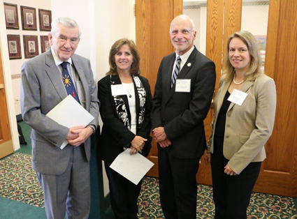 New York State Board of Regents Chancellor Emeritus Robert M. Bennett and Dr. Debra Colley, Niagara University executive vice president (formerly dean of the College of Education), are joined by Dr. Paul Dworkin, founder and president of Help Me Grow, and Amber Slichta, vice president of the Health Foundation for Western and Central New York.