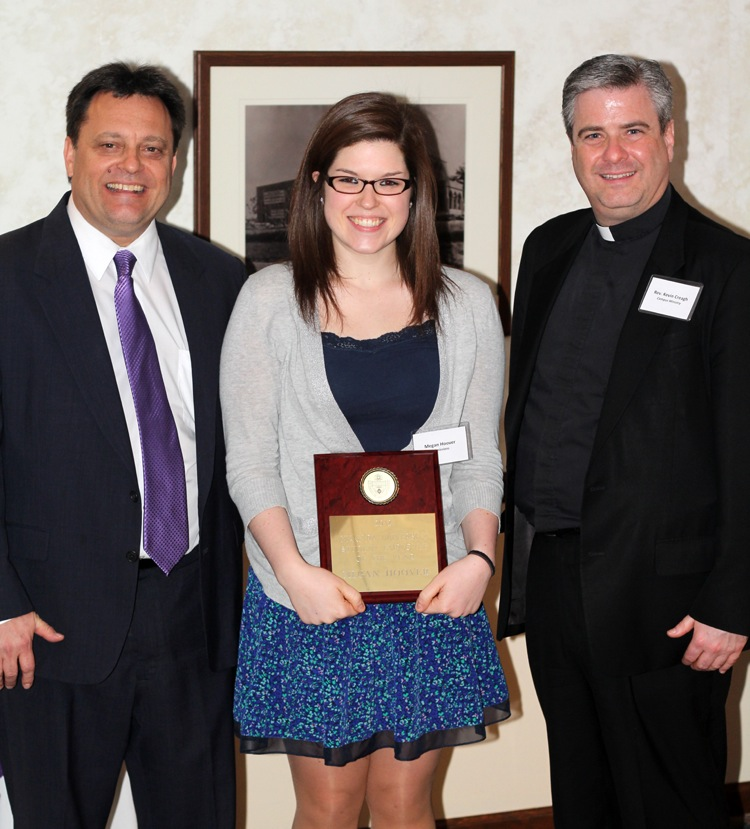 Megan Hoover receives the 2012 NU Student Employee of the Year award from Michael Konopski, dean of enrollment management, and the Rev. Kevin Creagh, C.M., associate vice president of campus ministry.