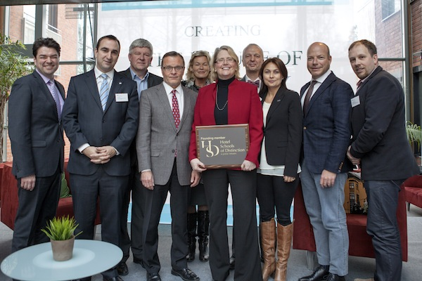 Dr. Deborah T. Curtis (center, holding plaque), director of Niagara University's Center for Events and Management Development, stands with fellow founding members of Hotel Schools of Distinction during the organization's first meeting.