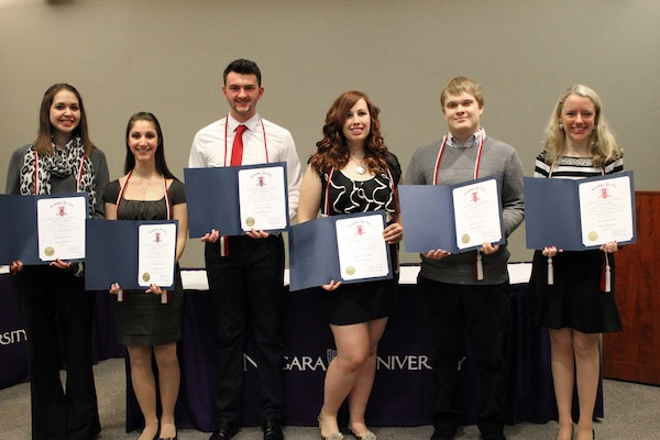 The newest members of Lambda Pi Eta are, from left, Kimberly Milleville, Kristen Cavalleri, Michael Hanton, Samantha Dreverman, Brendon Leet, and Clare Lewis.