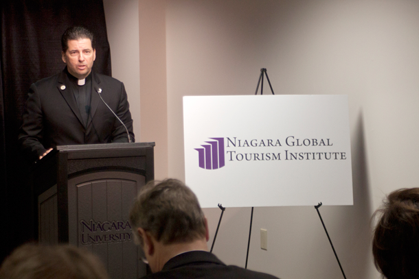 The Rev. James J. Maher, C.M., president of Niagara University, addresses the audience Thursday.