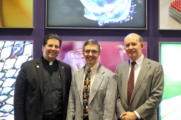 From left: Dr. David Holmes, director of global health education at UB's Jacobs School of Medicine and Biomedical Sciences centers, the Rev. James J. Maher, C.M., president of Niagara University, and Dr. William Cliff, the John J. Hughes, '67, M.D., Endowed Program Director of Pre-Professional Health.