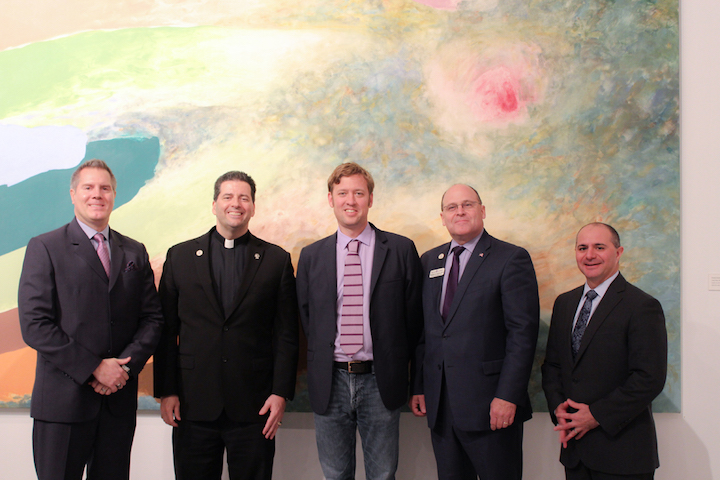 Anthony Townsend, center, is pictured with Dr. Kurt Stahura, dean of NU's College of Hospitality and Tourism Management; the Rev. James J. Maher, C.M., president of Niagara University; Dr. Tim Downs, NU provost; and Christopher Schoepflin, president of USA Niagara Development Corp.