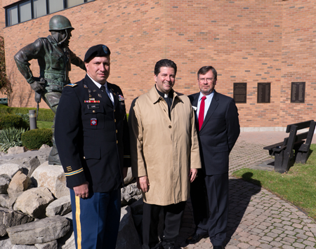 Pictured near the Korean War monument on Niagara University's campus are, from left, Lt. Col. Gary Love, chair of NU's military science department; the Rev. James J. Maher, C.M., Niagara president; and Robert Healy, the university's director of veterans services.