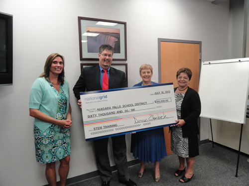 Pictured, from left, Lynn Tompkins of the Niagara Falls City School District, joins Dennis Elsenbeck, regional executive for National Grid, as he presents Niagara University Executive Vice President Dr. Bonnie Rose and Niagara Falls City School District Superintendent Cynthia Bianco a grant for $60,000 to train 45 Niagara Falls teachers in STEM and to host a summer STEM camp for 300 students at NU.