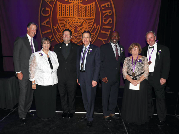 Pictured at Niagara University's 2016 President's Dinner are, from left, Jeffrey R. Holzschuh, chair of NU's Board of Trustees; Robyn L. Krueger, recipient of the St. Vincent de Paul Award; the Rev. James J. Maher, C.M., NU president; Dr. Gary D. Praetzel, Medal of Honor recipient; Legacy of Service Award honoree Thurman L. Thomas; and Caritas Medal recipients Dr. Frances E. Crosby and Brian P. Crosby.