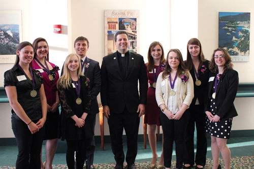 Pictured, from left: Kimberly Nedza, Samantha Livingston, Crystal Lorenzo, James Lioi, the Rev. James Maher (NU president), Haley Keeley, Amanda Smith, Margot Hickey and Kimberly Alexander. Not pictured: Emily Bork and Amber Markham.