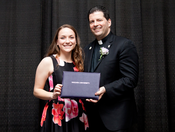 Megan Rogers and the Rev. James J. Maher, C.M., president of Niagara University.