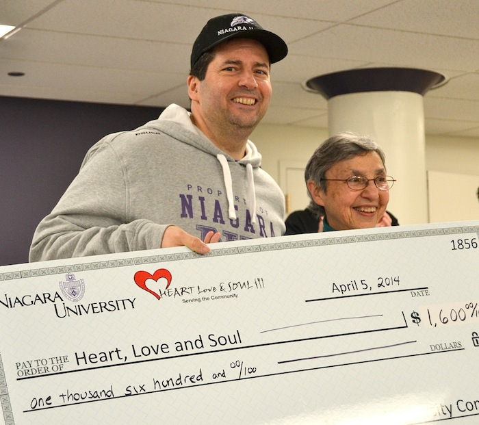 Following Niagara University's first-ever `Run Against Hunger,` the Rev. James Maher, C.M., NU president, presented a check for $1,600 to Sister Marygrace Polino, the bookkeeper and pantry manager at Heart, Love and Soul.