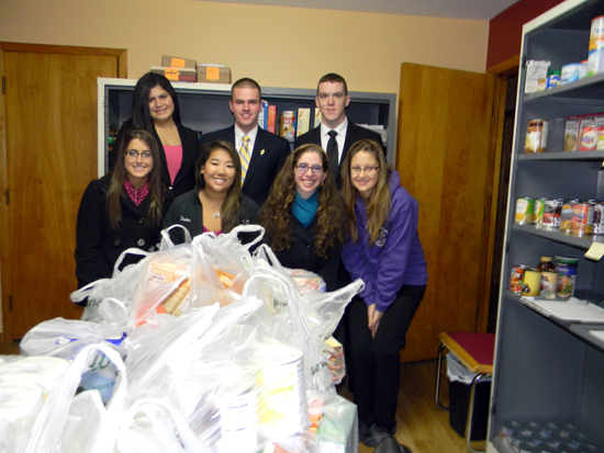 Members of Niagara University's Class of 2013 stop for a photo after delivering more than $700 worth of food and supplies to Divine Mercy food pantry in Niagara Falls. Back row, from left: Jeannine Alsous, Marc Skill and Daniel French. Front row, from left: Sarah Augostini, Sara Kates, Rebecca Immer and Logan Jensen.