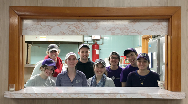 Vincentian seminarian Thomas King, pictured here in a black sweatshirt with students at the St. Vincent de Paul soup kitchen in Niagara Falls, became a very active member of the campus community during his apostolic month at Niagara University.