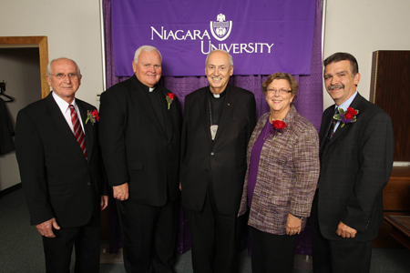 The Rev. Joseph L. Levesque, C.M., president of Niagara University (center), stands with honorees Thomas M. McDermott, the Rev. Michael Carroll, Karen A. Ballard and Fred Heuer.