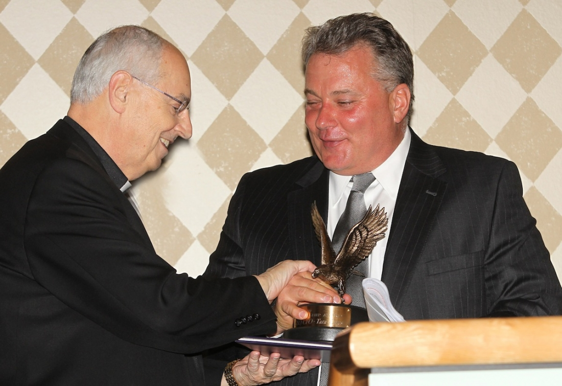 The Rev. Joseph L. Levesque, Niagara University president, presents the 2012 Corporate Leadership Award to Donald T. Denz, '80.