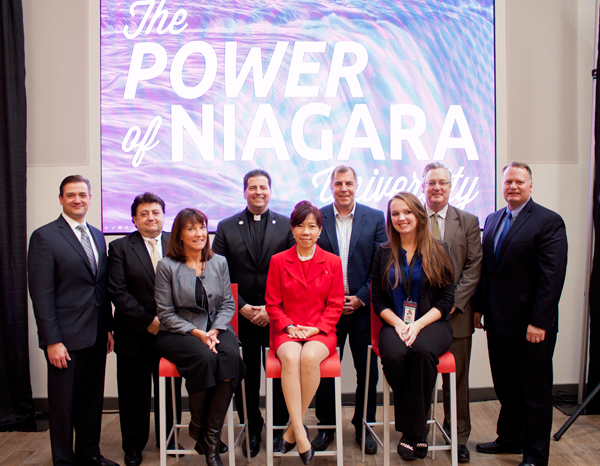 Present at Thursday's unveiling of the Niagara University Food Marketing Center of Excellence were, from left, John Persons, William J. Chiodo, William J. Chiodo, Jamie McKeon, the Rev. James J. Maher, Dr. Peggy Choong, Drew Cerza, Shannon Chowaniec, Dr. Paul Richardson and Robert Denning.