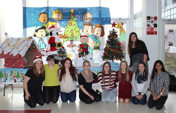 Students show off the Charlie Brown Christmas tree display as part of the holiday decorations. From left: Micheia-Rose Perreault, Katie Colby, Sierra Fruck, Alana Svensson, Madison Klidonas, Sabrina Seefeldt, Alexa Sass and Purvi Patel. Kennedy Heaton is standing in back.