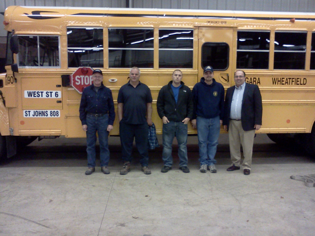 Shown from right are Mike Dallessandro, N-W transportation director; and Lewiston No. 2 members Tim Stedge, lieutenant; Chris Geilanai, firefighter; Bill Senick, chief; and Bob York, fire police.