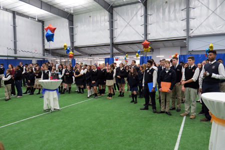 Students look on as the ceremony unfolds and the ribbon is cut.