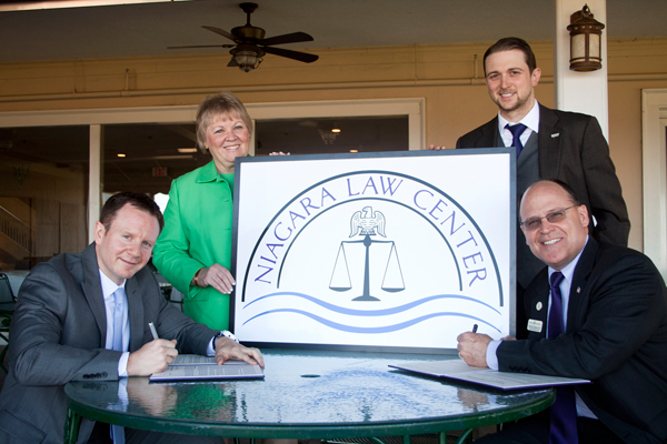 Pictured, from left: BANC President Matthew Mosher, Esq.; BANC Vice President Patricia McGrath, Esq.; NU Provost and Chief Academic Officer Timothy Downs, Ph.D.; and NU Assistant General Counsel and NU CLE Program Director Ryan Thompson, Esq.
