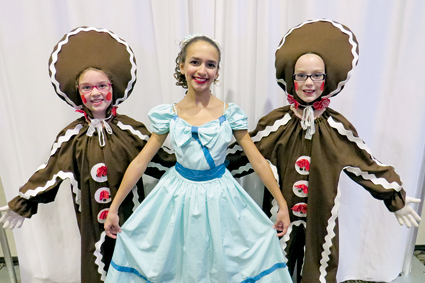 Gingerbreads Natalie Dunlap, 9, and Madison Sabourin, 10, both of Niagara Falls, flank dancer Isabella Guerrucci, 12, of Lewiston.