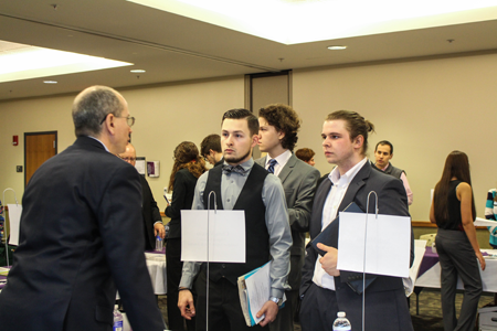 NU students David Yarger and James Burns speak with CNHI publisher Chris Voccio.
