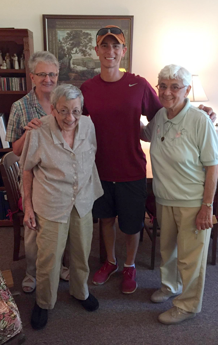 Graig Presti, a 1993 graduate of Stella Niagara Education Park, meets with Stella administrators Sister Margaret, Sister Nicholas Macoretta and Sister Lucina during a visit last summer.