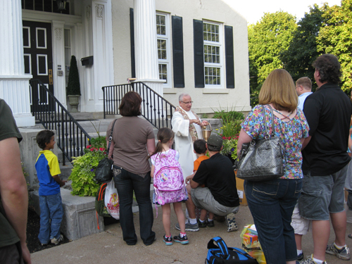 St. Peter R.C. Church in Lewiston recently held its `Blessing of the School` along with a family picnic. Families were asked to gather on the front lawn of the rectory where Father Michael Zuffoletto began the school year with a family blessing.
