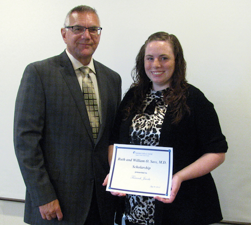 Taraneh Jacobs, left, receives the 2014 Ruth and William O. Sass, M.D. Scholarship award from President and CEO Joseph A. Ruffolo at Niagara Falls Memorial Medical Center.