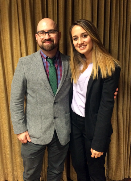Niagara University student Jennifer Gallo, right, smiles with Dr. Joseph M. Sirianni, associate professor of communication studies, after receiving the May C. Randazzo Memorial Scholarship.