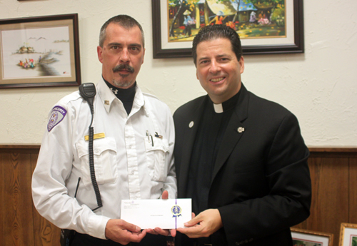Peter Stansberry, left, is lauded by the Rev. James J. Maher, C.M., Niagara president.