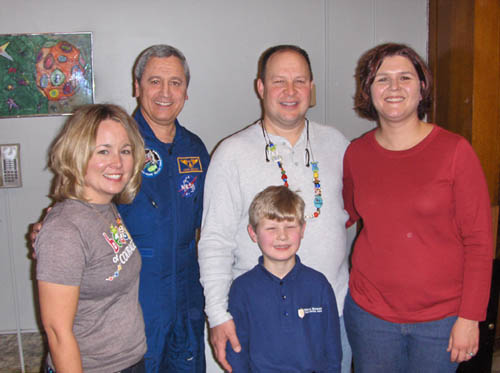 Pictured (left to right), Jean Baruch, BOC; Dr. Larry Delucas, NASA Shuttle mission STS-50; and Rob and Kristi Moore of Moore for Kids. Their son, Sam Moore, pictured front, is a second-grade student at Stella.