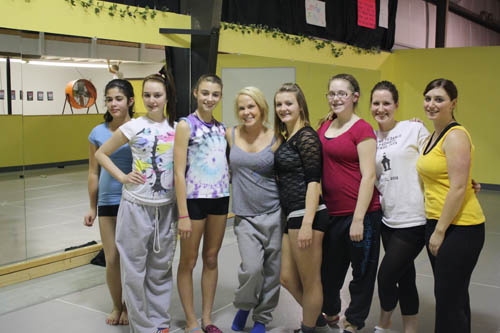 Kim McSwain (center, gray) is pictured with some of the Time to Dance dancers.