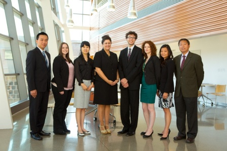 A team of doctoral students in UB's School of Engineering and Applied Sciences have designed a mobile app that aims to reduce avoidable hospital readmissions. The team is, from left to right, Dapeng Cao, Nicolette McGeorge, Yuan Zhou, Sabrina Casucci, David LaVergne, Judith Tiferes-Wang and Theresa Guarrera. Also pictured is Professor Li Lin, an adviser on the project.