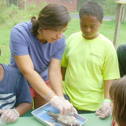 A camper (right) looks on during a fish dissection activity led by Cradle Beach science camp counselor Intefada Wardia. (Credit: Cradle Beach)