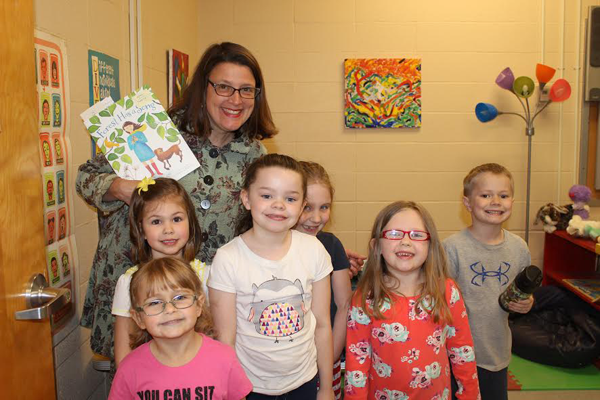 Author Amy Ludwig VanDerwater poses with students Madilyn Tabor, Rebecca Deschamps, Lilly Lapp, Laila Vacanto, Janice Hanna and Zachary Lapp.