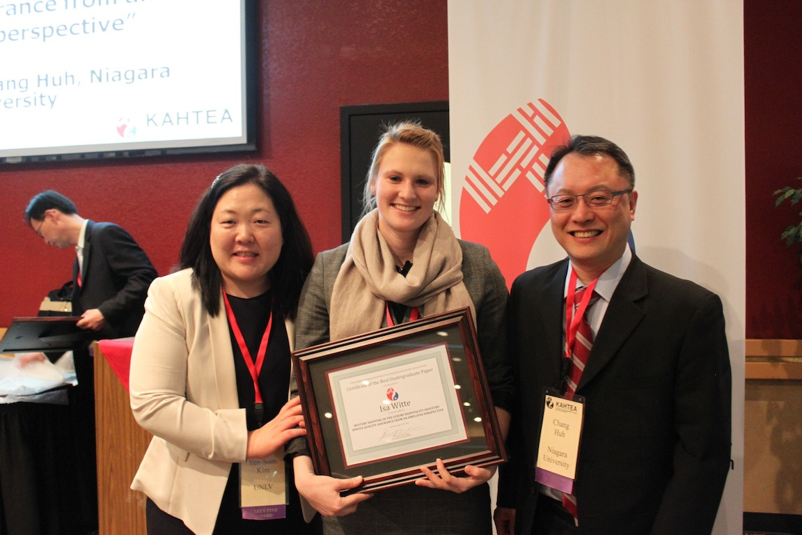 Niagara University student Isa Witte, center, receives her KAHTEA award.