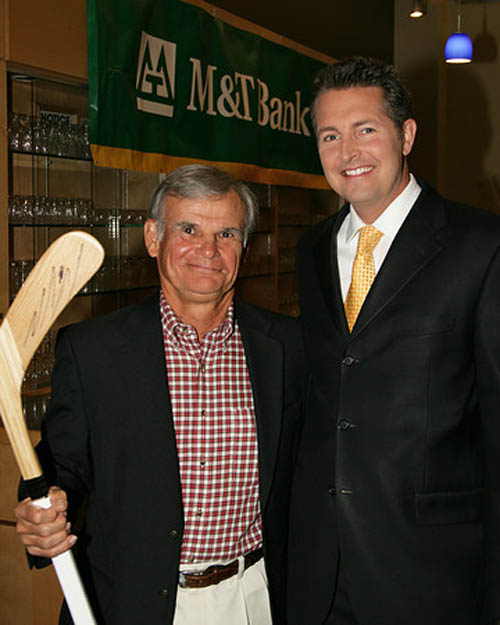 Aaron Mentkowski,  WKBW-TV Channel 7 meteorologist, joins with Dick Molnar, vice president of construction at Calamar, who was the winning bidder of an autographed Buffalo Sabres hockey stick at the event. (photos by Kevin Blakely)