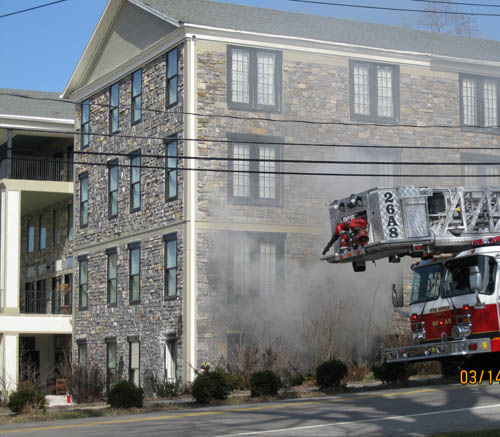 Firefighters wasted no time in responding to a fire Monday afternoon at the Barton Hill Hotel & Spa in the Village of Lewiston. (photo by George VanHoose)